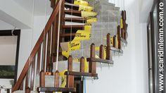 greutati pe scara interioara din lemn cu trepte de lemn suspendate pe corzi pret
