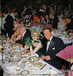 The Tarzan of that day, Lex Barker, with his wife, actress Arlene Dahl, at a Hollywood New Year's party, 1952.