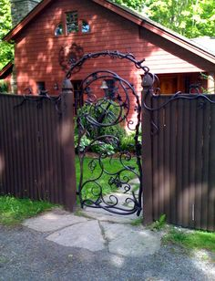 Really shows this guys sense of whimsy. Super gate and trim from Graney Metal Design in Sheffield, MA