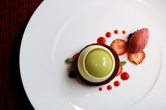 Pistachio cremino with almond biscuit and strawberry mint sorbet.