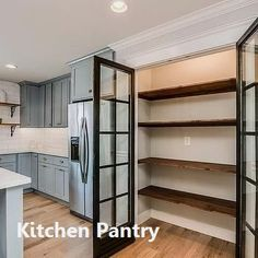 This traditional kitchen optimizes its space with a built-in pantry with . This traditional kitchen optimizes its space using a built-in pantry with glass doors and stacked salvaged wood shelving Kitchen Pantry Doors, Kitchen Storage, Storage Room, Kitchen Wood, Glass Kitchen, Space Kitchen, Kitchen Pantries, Kitchen Shelves, Kitchen Cabinets
