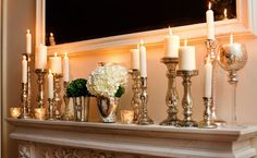 different heights and sized candles create a romantic atmosphere. Mirror intensifies the feeling.