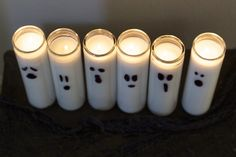 These diy halloween decorations costs dollars to make yet looks great. Turn cheap candles into Halloween ghost candles.