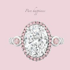 ALEGRIA. Spanish for 'happiness', the radiating light from this custom-made 3.18ct Oval White and Argyle Pink Diamond Engagement Ring is guaranteed to generate a never-ending smile.