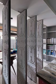 Love this idea for break between foyer and dining room -Rotating Wall Panels