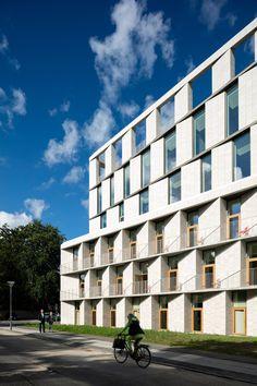 3XN completes Copenhagen hospital building featuring slanted stone walls.
