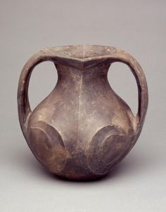 Chinese (Warring States period–early Han Dynasty)   Double-handled Amphora, ca. 3rd–2nd century BCE  Earthenware  8 x 7 x 5 1/2 in.