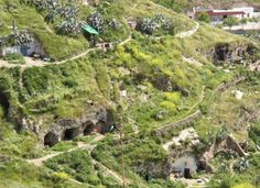 Granada Cave Homes - Southern Spain has a long history of people living in caves. These homes have been built into the clay soil over the course of centuries. They feature things like modern electricity and air conditioning.