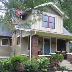 exterior paint. sage green, cream, red accent.