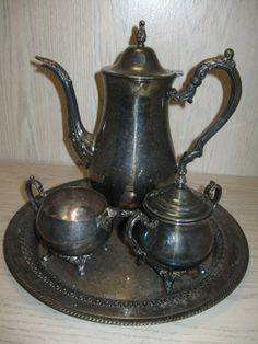Silver Plate Tea Pot Set Oneida 1935Present Wm by NANCYSANTIQUES, $49.99 Visit Our Antique Store More Tea Pots to Choose from.