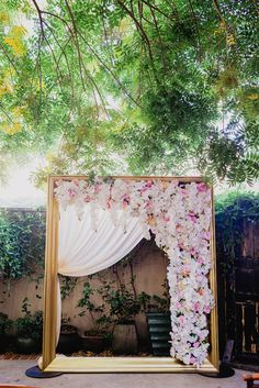 Golden Wedding Arch Draped With Florals | Anais Event Planning & Design | MIlou + Olin Photography https://www.theknot.com/marketplace/milou-+-olin-photography-sacramento-ca-562449