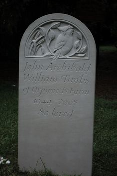 portland headstone with carving of owl