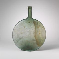 Glass lentoid bottle Period: Late Imperial Date: 4th century A.D. Culture: Roman Medium: Glass; blown Dimensions: Overall: 8 3/8 in. (21.3 cm) Other: 6 1/2 x 15/16 in. (16.5 x 2.4 cm) Classification: Glass Credit Line: Gift of Henry G. Marquand, 1881