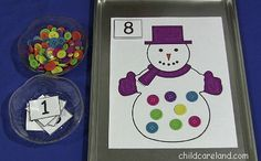 This is a great activity for a math center. Children place a number card on the snowman mat and then place the correct number of counters (we used buttons) on the snowman.