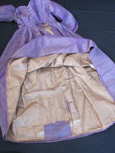 "Pretty Original Civil War Era Purple Changeable Silk Wool Dress | eBay seller ariava, fully lined in tan polished cotton, hand & machine sewn, piping at armscyes, neck & waist, front button closure, self fabric & silk ribbon trim; bust: 32""; waist: 24""; front length: 51"", hem circumference: 112"""