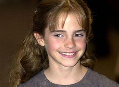 2001: Emma Watson arrives for the world premiere of Harry Potter and the Sorcerer's Stone...in a t-shirt. This totally wouldn't happen today.  [Photo by: Getty Images]