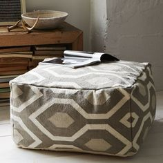 A nice neutral mushroom color - I need a pouf!!! this looks so cozy.  Courtyard Dhurrie Pouf | west elm