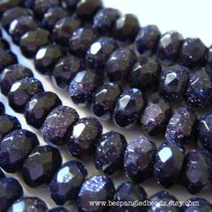 beautiful 8 x 4 mm faceted deep midnight blue goldstone beads, dark navy color with sparkly copper flecks. Great price!  #etsy #beads #strand #jewelry #supply #goldstone #faceted