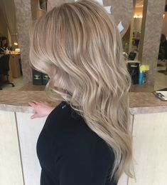 Pearl icy blonde summer hair color highlights pale golden blonde beige done by IG: hairbynickyz