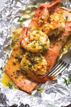 Grill Foil Packet Dinners That Make Cleanup A Breeze Fillet Packet Dinners_Garlic Dijon Packs Shrimp and Salmon Foil Baked Salmon Recipes, Fish Recipes, Seafood Recipes, Cooking Recipes, Healthy Recipes, Garlic Recipes, Recipe For Salmon And Shrimp, Healthy Meals, Seafood Meals