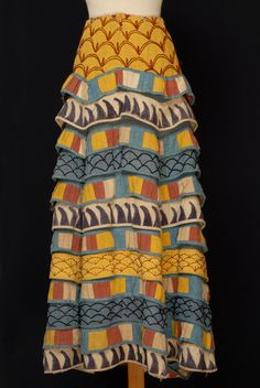 Minoan dress- this one highlights the often aquatic motif that decorated Minoan art and crafts.