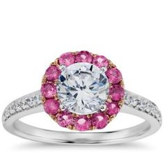 Enduring and elegant, this halo pink sapphire and diamond engagement ring features a frame of pink sapphires set in 18K rose gold contrasted with pave-set diamonds along the 18k white gold ring design. $1,375.00 by BlueNile