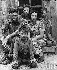 Portrait of Dust Bowl farmer John Barnett and his family. Oklahoma, 1942.  By Alfred Eisenstaedt