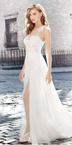 Ivory English net sheath bridal gown with front slit, lace appliqued ruched English net one shoulder bodice, sweetheart neckline, sweep train.