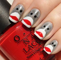 Sock monkey nail art...these are hilarious. I should attempt to grow my nails out just for these