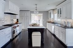 Randy Heller Inc. / Pure & Simple Interior Design kitchen with Sorenson Lanterns above a marble island