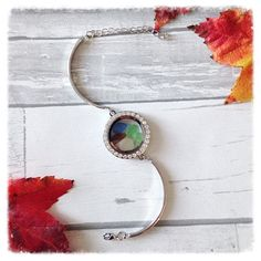 Beautiful glass locket bracelet with mini pieces of Sea Glass  This unique piece is a perfect representation of Nova Scotia, Canadas Ocean Playground.  Each piece is 100% unique , made with genuine sea glass. The glass has not been altered in anyway and is exactly as it was picked along the shores of our beautiful coast line.   💙 Made with Love 💙