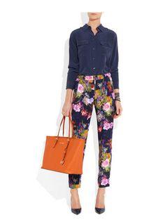 Floral print pants, navy blue shirts and orange shopper