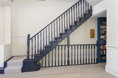 Staircase painted in Farrow & Ball Railings, the contrast is sharp and eye catching