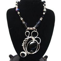 Black Onyx stones dances throughout this statement necklace.  By Detroit Jewelry Artist Rosemary Summers.