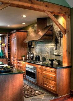 beautiful wood cabinets; love the post & beam!