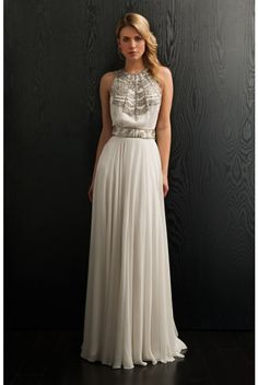 1970s inspired glamour from Amanda Wakeley, the Cleopatra wedding dress is stunning. We love the gold embellishment on the front and the show stealing low slung back with crystal rope detailing.  Regal price tag though :(