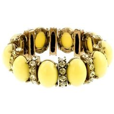 In love with this yellow stone and bling bracelet. w-a-n-t !