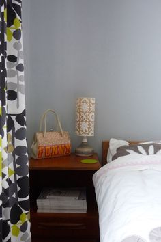 Image above: The lampshade is by Helen Rawlinson, the base is made in Anglesey, but found in a secondhand shop. The Funny handbag is by Antoni & Alison and is too lovely to store away when not in use.