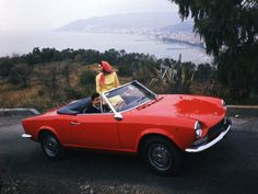 Legendary Designer Tom Tjaarda on the Eternal Beauty of Italian Cars | Tom Tjaarda's Fiat 124 Spider on the road in the 1960s. | Credit: Mondadori Portfolio/Getty Images | From Wired.com