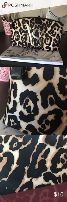 Victoria Secret bag This is a cheetah print bag from Victoria Secret! I did use this bag as a makeup bag so it does has some stains from the makeup on the inside and some spots on the outside. Overall it's in good condition, but there are some spots such as in the second picture is a line from my eyeliner on the outside of the bag. It's a really cute bag overall and it's perfect to hold makeup or whatever else you can think of! :) Victoria's Secret Bags Cosmetic Bags & Cases