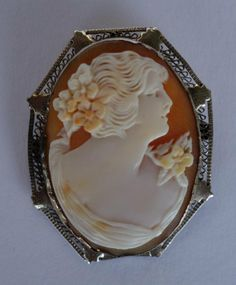 Carved Shell Cameo Depicting A Woman With Flower In Her Hair And On Her Gown, Mounted In 14k White And Yellow Filigree Gold Surround, Hinged Pin On Back To Wear As A Brooch And Hinged Bail To Wear As A Pendant   c.1900