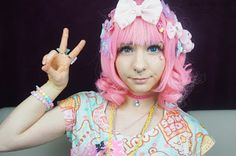 The wig has straight tresses that grows into bunch-y onion rings towards the tips.  Buy here: http://www.uniqso.com/cosplay-wig-touhou-project-saigyouji-yuyuko?search=%20Saigyouji%20Yuyuko?tracking=530071e2cf67c