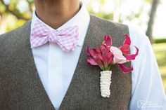Adorable pink boutonniere to compliment the  groom's precious bowtie. Created by Passion Roots, Hawaii Wedding Florist. www.passionroots.com