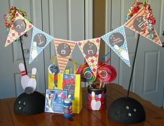 A little spray paint to a foam ball and dowel rods and you have an adorable stand for a banner.