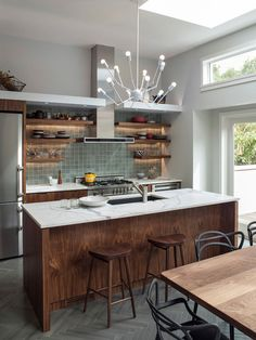 Contemporary Kitchen by Hart Wright Architects, AIA [I love the back splash, floating shelves, vent, natural lighting and chandelier...hh].
