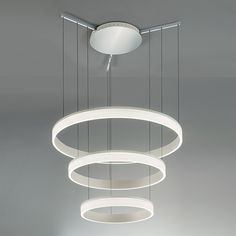 Contemporary aluminium ceiling pendant with three tiers and an opaque acrylic diffuser from Chelsom. The Rings 3 Tier Led Pendant has a textured aluminium paint finished ceiling rose and three layered, round frames. The ceiling rose also features polished chrome arms from which suspended cables hang the frame. A series of halo pendants house warm white LED lights that will illuminate the space of your choosing. The fittings of the pendant can also be adjusted while the ceiling pendant comes…