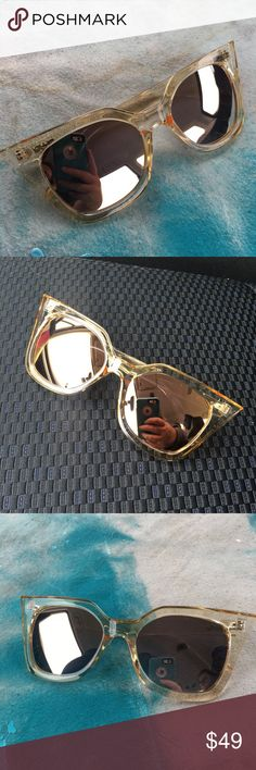 Quay Australia Harper Sunglasses Gold Mirrored Quay Australia Harper Sunglasses  Golden Lucite with Golden Mirrored Lenses  These statement-making cat eye sunnies will keep heads turning. Featuring dramatically sharp wings, a molded nose bridge and bold frame.  Polycarbonate Frame. Polycarbonate Lens. Stainless Steel Hinges. 100% UV protection. Quay Australia Accessories Sunglasses