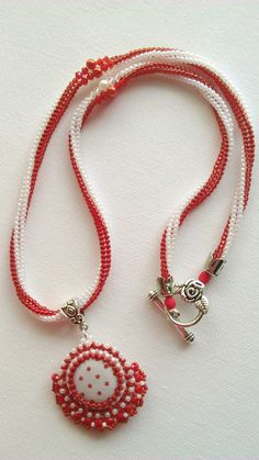 red dotted button pendant