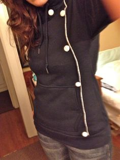 Not so easy looking to me, but a cute re-purposed over-sized sweatshirt turned into fitted shirt. Cute!