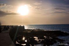 El Malecón- the sun setting over Cuba.